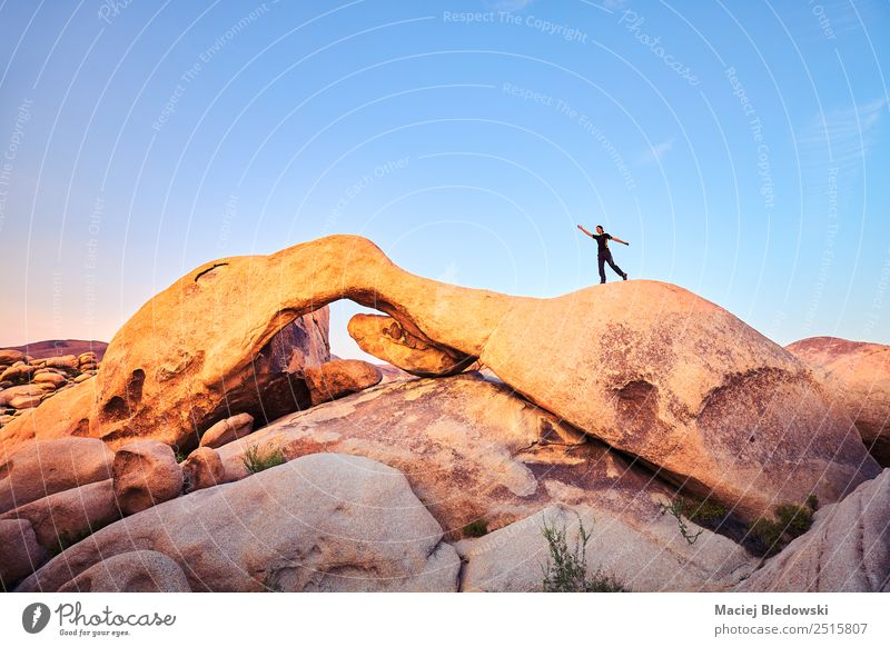 Rock formations at Joshua Tree National Park with female climber Lifestyle Joy Vacation & Travel Adventure Freedom Expedition Human being Woman Adults 1
