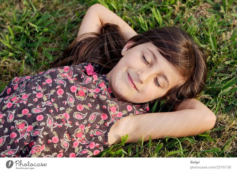 Adorable girl relaxed on the green grass Woman Child Human being Nature Vacation & Travel Youth (Young adults) Summer Green Sun Flower Relaxation Joy Adults