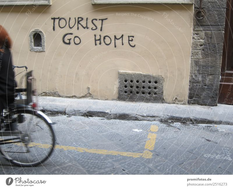 Graffiti: Tourist go home. By Alexander Hauk Life Human being Art Artist Street Bicycle Adventure Aggression Emotions Money Break taboo Luxury