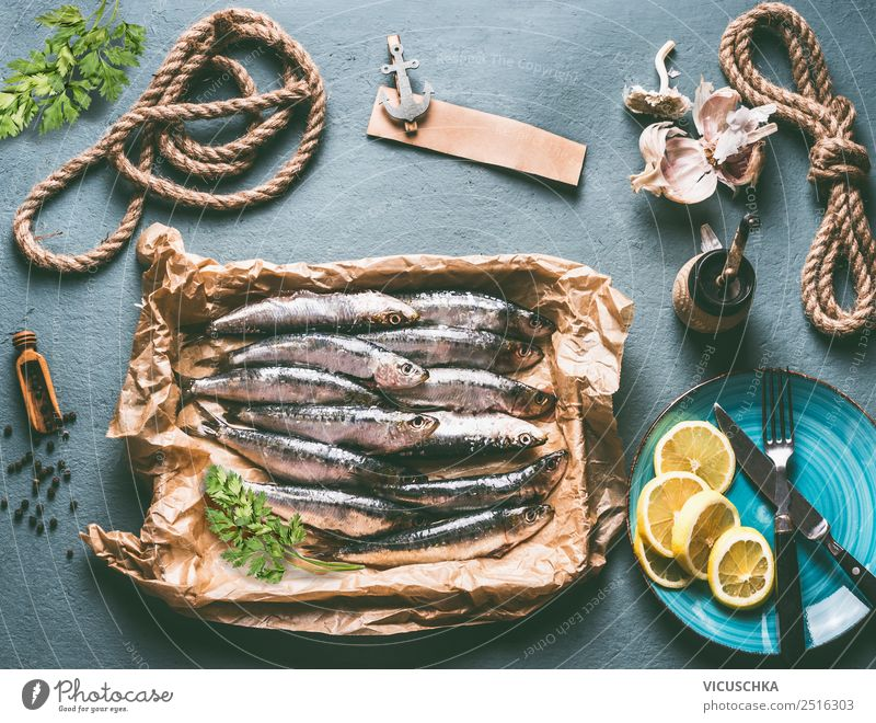 Sardines on the kitchen table with ingredients Food Fish Nutrition Lunch Dinner Buffet Brunch Organic produce Vegetarian diet Crockery Plate Cutlery Style