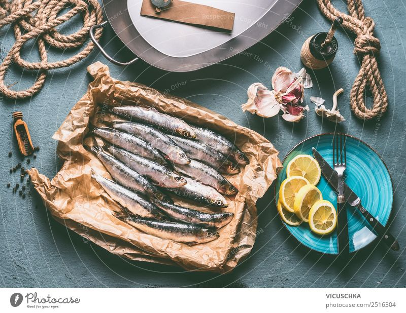 Fresh sardines on the kitchen table Food Fish Herbs and spices Cooking oil Nutrition Diet Crockery Style Design Healthy Healthy Eating Table Kitchen Restaurant