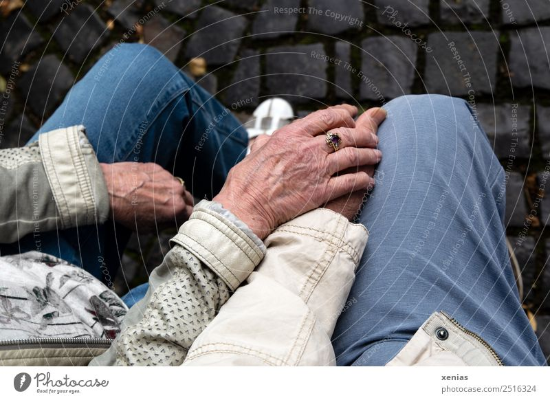 mature hands of seniors rest on knees Human being Woman Adults Man Female senior Male senior Grandparents Family & Relations Partner Hand Fingers Legs 2 Jeans