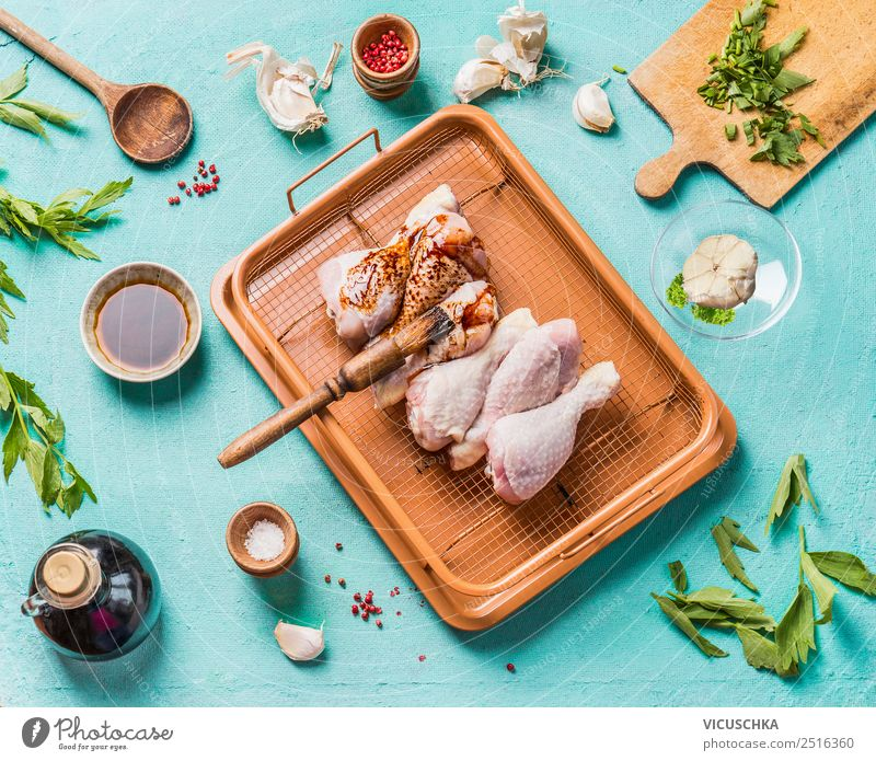 Preparing marinated chicken legs Food Meat Herbs and spices Cooking oil Nutrition Lunch Dinner Organic produce Diet Crockery Style Design Living or residing