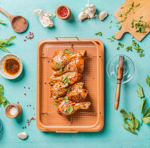 Marinated chicken legs on grill rack Food Meat Nutrition Lunch Dinner Organic produce Crockery Bowl Style Design Kitchen Barbecue (apparatus) Chicken Sauce