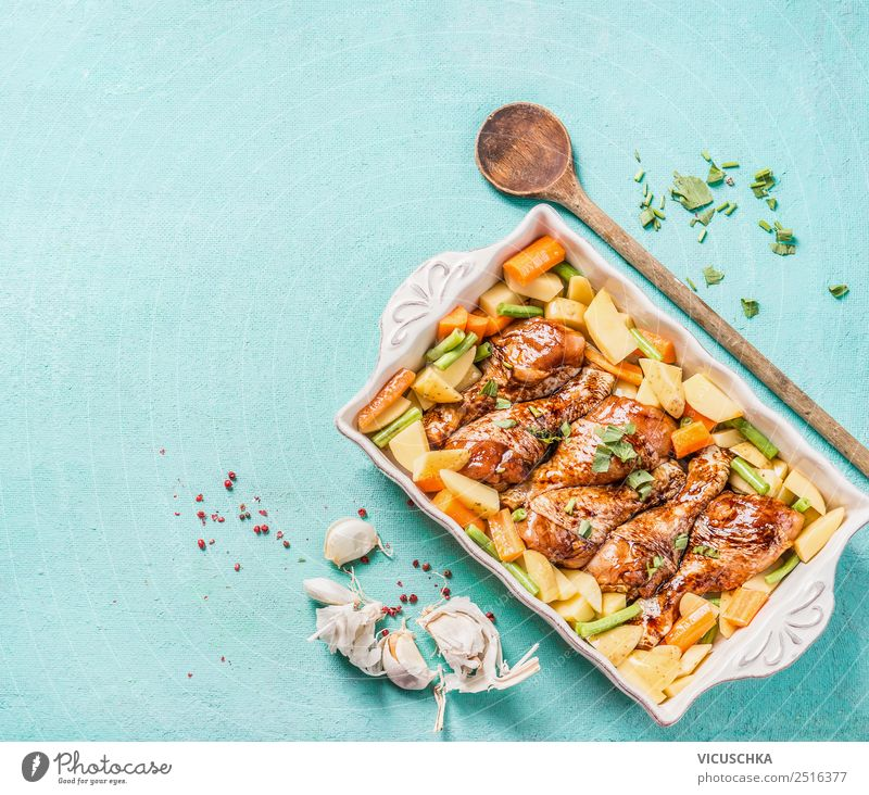 Chicken legs with vegetables in baking pot Food Meat Vegetable Nutrition Lunch Dinner Organic produce Crockery Style Design Table Kitchen Wooden spoon Cooking