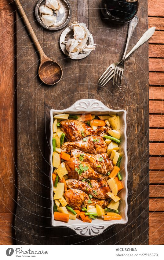 Chicken legs with vegetables in casserole dish Food Meat Vegetable Nutrition Lunch Dinner Organic produce Diet Crockery Style Design Living or residing Table