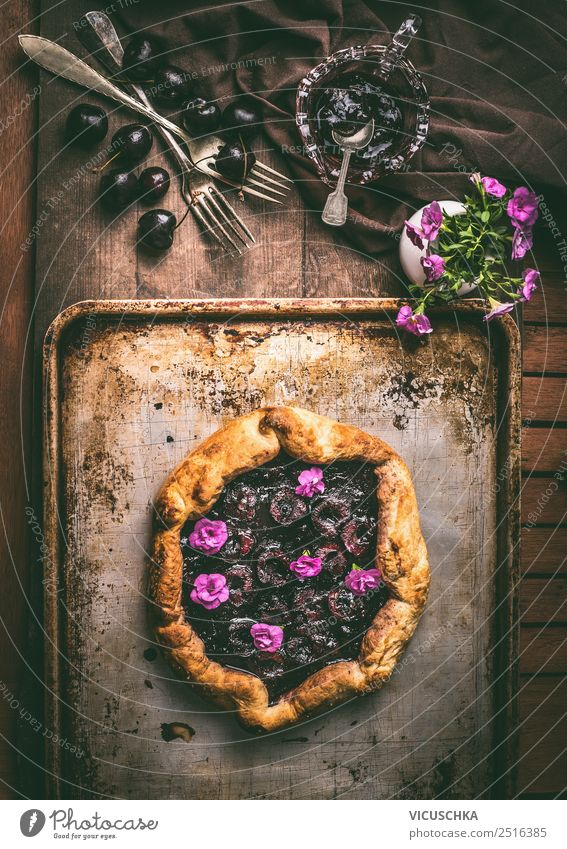 Plum cake on a rustic kitchen table Food Fruit Cake Dessert Nutrition Organic produce Crockery Elegant Style Summer Living or residing Table Design Still Life