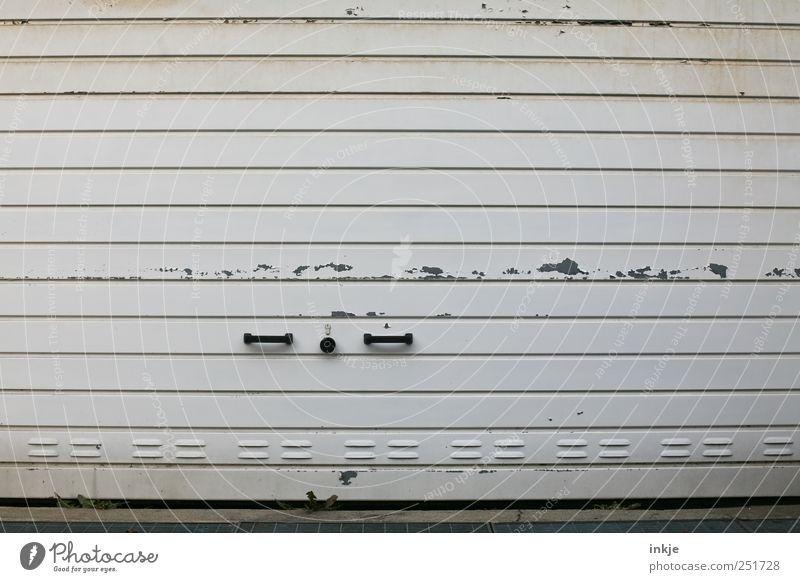 that's a garage door... Logistics Retirement Closing time Garage door Transport Door handle Lock Metal Old Dirty Broken Gloomy Gray Black White Decline Varnish