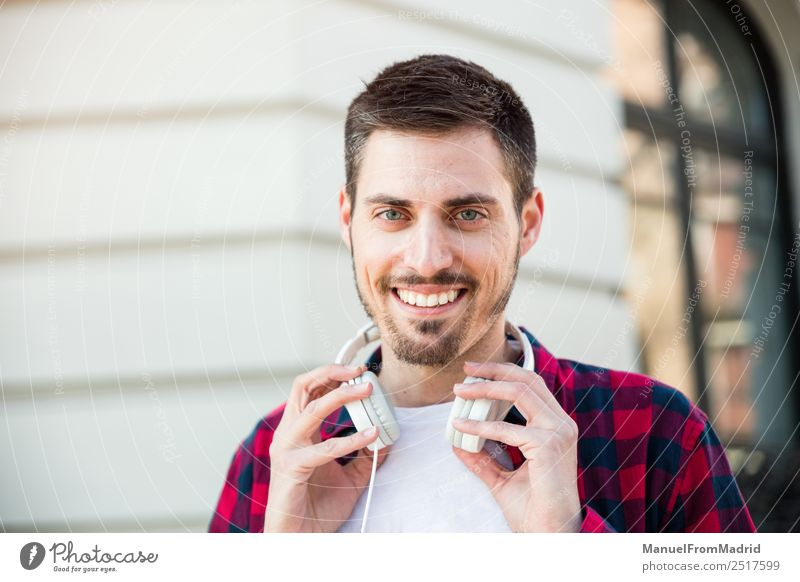 portrait of young cheerful attractive man outdoors Lifestyle Style Happy Human being Man Adults Street Fashion Smiling Cool (slang) Friendliness Happiness