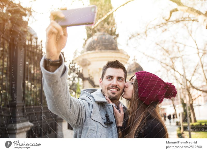 couple taking selfie in the street Lifestyle Elegant Style Joy Happy Beautiful Vacation & Travel Tourism Sightseeing Winter Telephone PDA Camera Human being