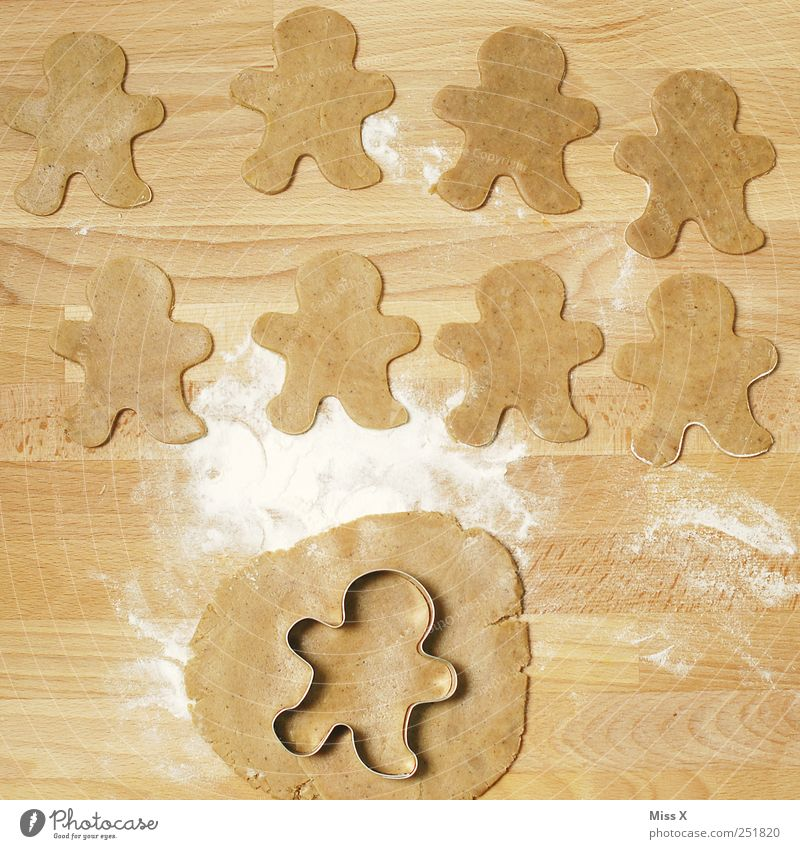 nine little males Food Dough Baked goods Candy Nutrition Delicious Sweet Brown Cookie Gingerbread Man gingerbread man Many Row Flour Christmas biscuit