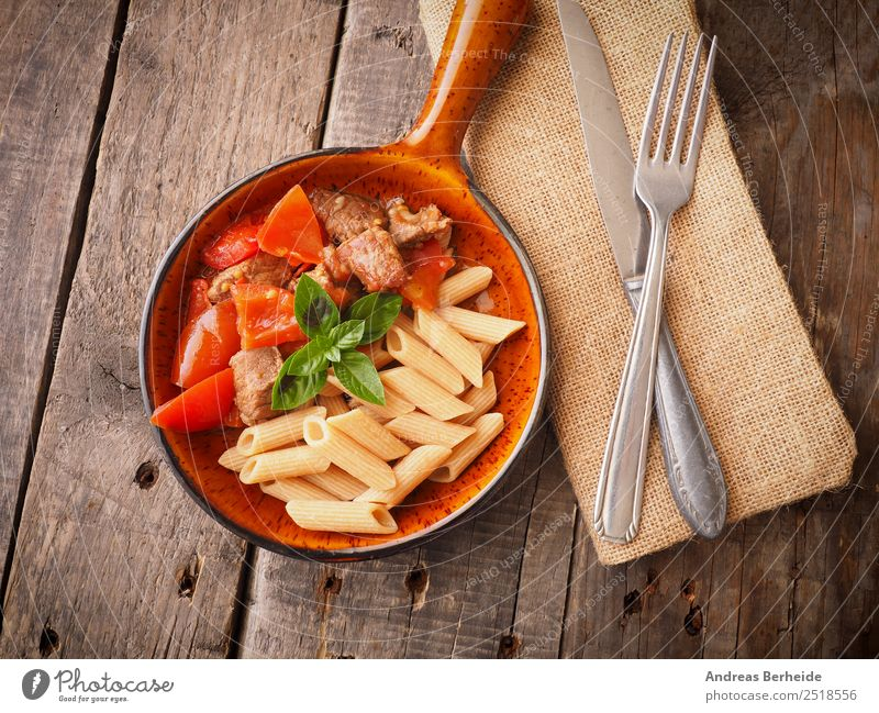 Organic beef goulash with wholemeal penne Meat Lunch Banquet Organic produce Winter Delicious Background picture dish hungarian soup Sauce rustic traditional