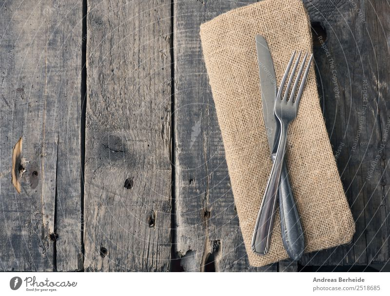 Old cutlery on a wooden table Lunch Banquet Cutlery Knives Fork Style Restaurant Retro antique Background picture black bare brown cloth copy decoration dining