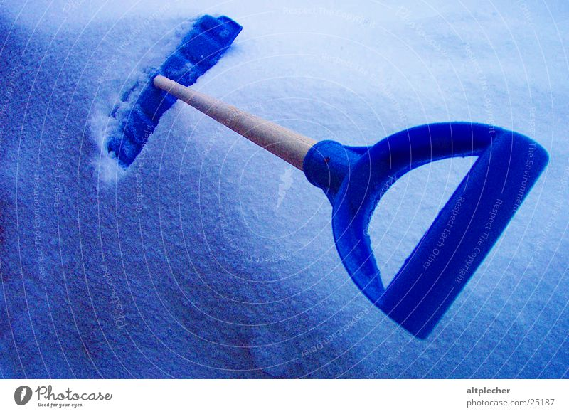 Resting the implement Snow shovel Cold Winter Leisure and hobbies Blue