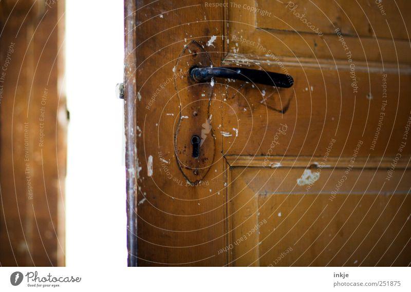 Old wooden door Door Door handle Door lock Dirty Bright Brown Black White Moody Beginning Discover Expectation Mysterious Curiosity Far-off places Decline