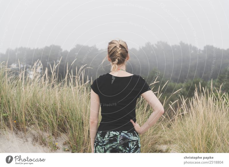 Rear view of a blonde woman looking into foggy landscape Vacation & Travel Adventure Far-off places Woman Adults 1 Human being 30 - 45 years Bad weather Blonde