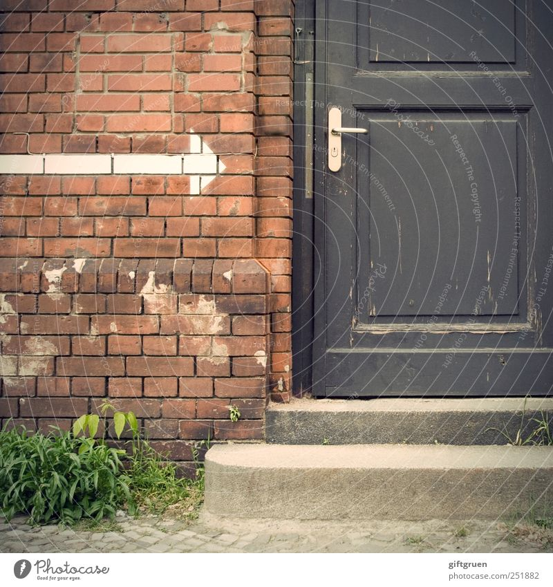 Come in! Wall (barrier) Wall (building) Stairs Facade Door Door handle Communicate Closed Arrow Signs and labeling Brick Plant Foliage plant Arise Entrance