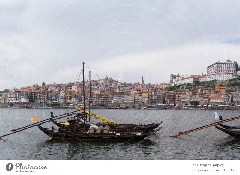 Postage with boats in the foreground Sky Clouds Coast River bank Douro Porto Town Downtown Outskirts Old town Skyline Navigation Ferry Sailing ship Rowboat