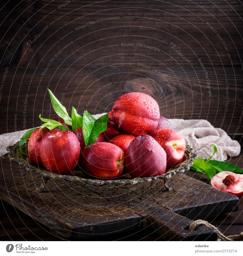 red ripe peaches nectarine Fruit Dessert Nutrition Plate Bowl Summer Table Leaf Wood Fresh Above Juicy Brown Green Red Mature Peach Nectarine background food