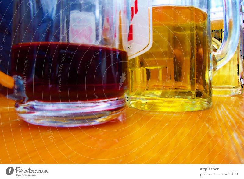 Wine on beer Red wine Beer Wooden table Drinking Beverage Alcoholic drinks Glass Side by side Detail Close-up Carry handle Half full Beer glass