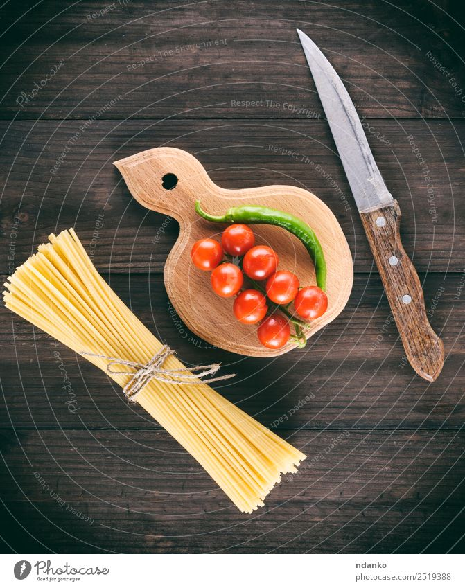 raw Italian long pasta Colour Red Black Yellow Above Fresh Large Vegetable Tradition Long Cooking Mature Baked goods Chopping board Tomato Dough
