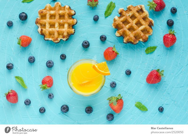 Waffles and red berries, orange juice and mint leaves Vacation & Travel Summer Plant Blue Green Red Leaf Dish Lifestyle Yellow Spring Brown Above Fruit