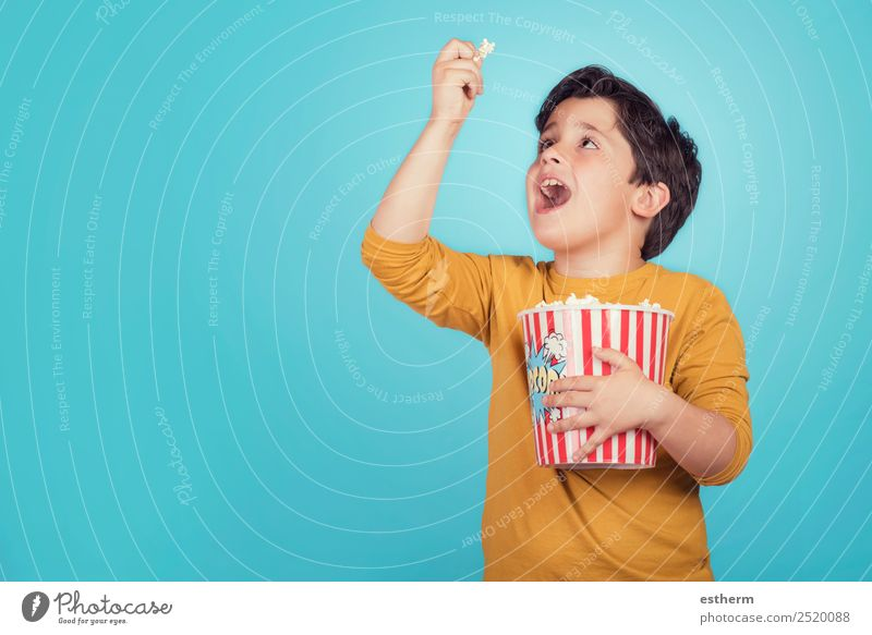 happy boy with popcorn Food Eating Fast food Lifestyle Joy Leisure and hobbies Entertainment Human being Masculine Child Boy (child) Infancy 1 8 - 13 years