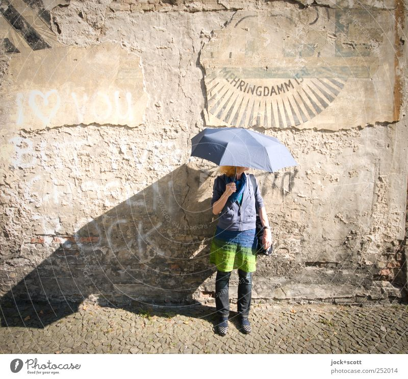 her umbrella is afraid of water Human being Woman Old Joy Adults Life Wall (building) Graffiti Style Wall (barrier) Stone Brown Stand 45 - 60 years Esthetic