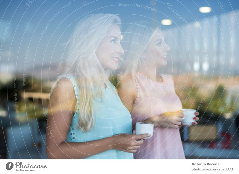 Sisters behind the glass Woman Human being Youth (Young adults) Beautiful 18 - 30 years Adults Lifestyle Feminine Happy Friendship Smiling Stand Coffee Drinking