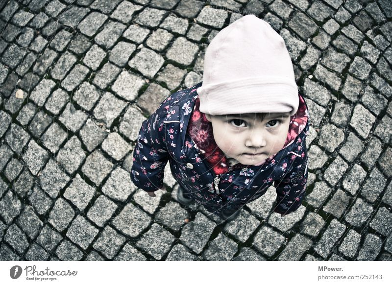 ...when I grow up... Child Girl Infancy Head 1 Human being 1 - 3 years Toddler Street Freeze Small Blue Pink Looking Eyes Cap Jacket Paving stone Looking up