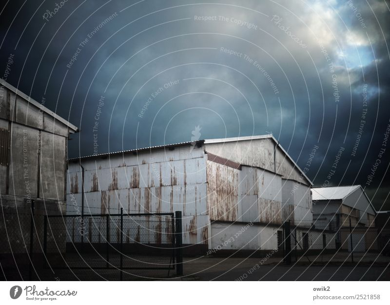 deposit Sky Clouds Corrugated iron wall Warehouse Metal Old Threat Dark Colour photo Subdued colour Exterior shot Deserted Copy Space left Copy Space right