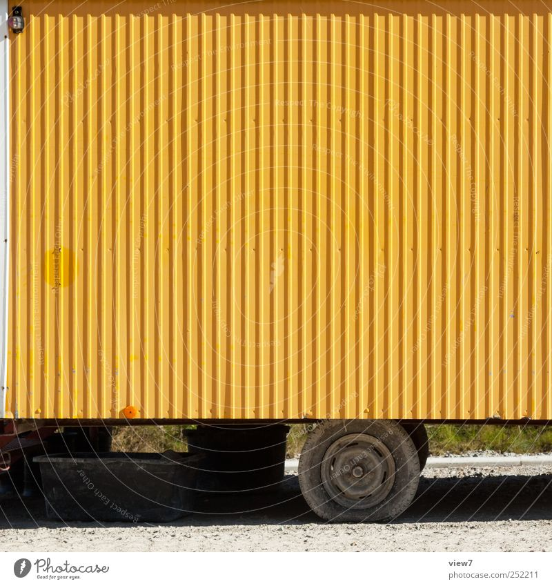 Car yellow Construction site Logistics Wall (barrier) Wall (building) Transport Means of transport Vehicle Site trailer Trailer Metal Line Stripe Old Authentic