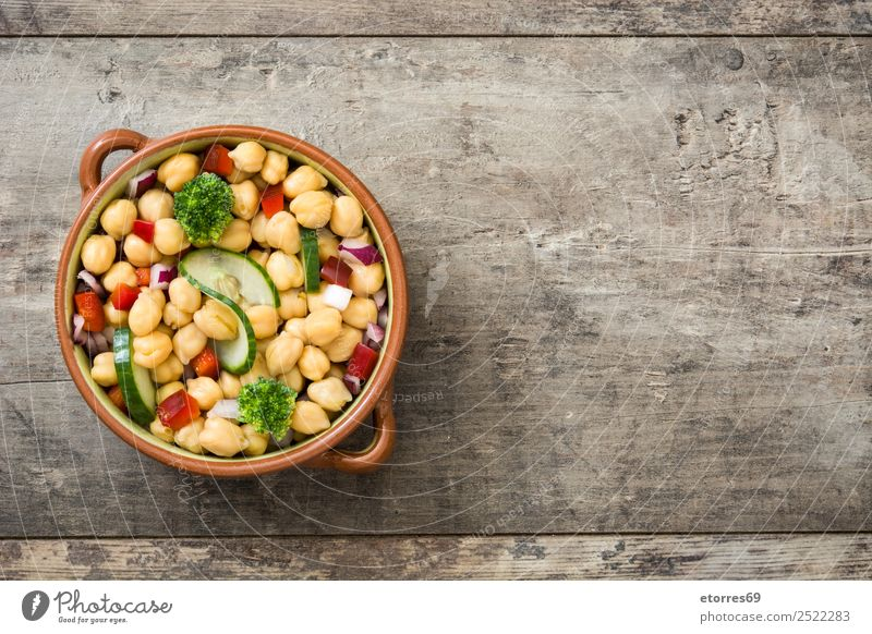 Chickpea salad in brown bowl on wood Food Vegetable Nutrition Lunch Vegetarian diet Diet Healthy Healthy Eating Wood Fresh White Chickpeas Salad Cucumber Onion