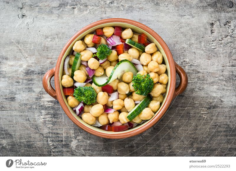 Chickpea salad in bowl on wooden background Chickpeas Salad Cucumber Onion Broccoli Vegetable Vegan diet Vegetarian diet Pepper White Healthy Healthy Eating