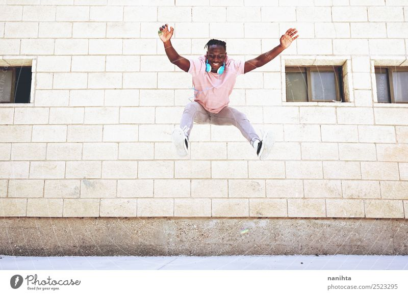 Happy young man jumping in an urban place Human being Youth (Young adults) Man Town Young man Joy Lifestyle Adults Healthy Funny Style Freedom