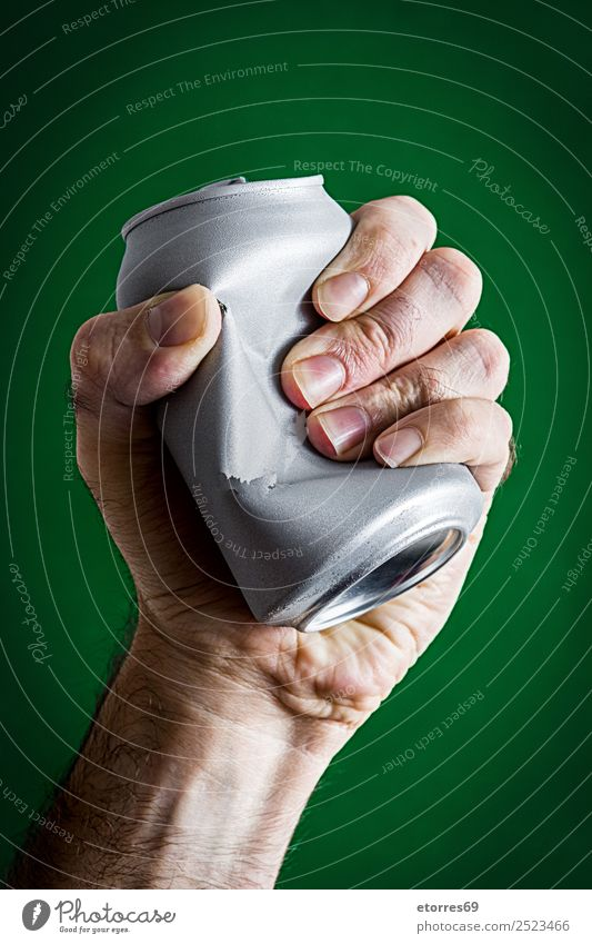 Man crushing a can Adults Hand 30 - 45 years Environment Climate change Metal Aggression Green Silver Crush Aluminium Container Environmental protection Tighten