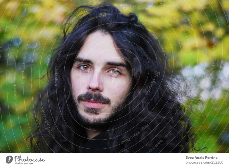 . Young man Youth (Young adults) 1 Human being 18 - 30 years Adults Environment Hair and hairstyles Brunette Long-haired Curl Facial hair Uniqueness