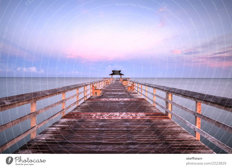 Early sunrise over the Naples Pier Relaxation Vacation & Travel Trip Summer Sun Beach Ocean Waves Nature Landscape Sky Clouds Coast Wood Water Blue Violet Pink