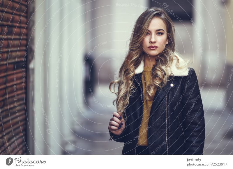 Blonde woman in urban background. Woman Human being Youth (Young adults) Young woman Beautiful White Winter 18 - 30 years Face Street Adults Lifestyle Autumn