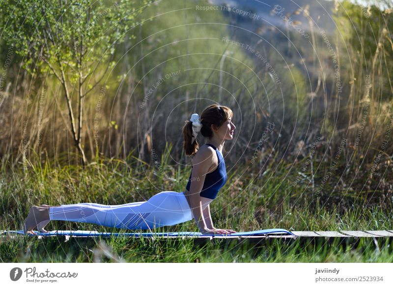 Young woman doing yoga in nature. Woman Human being Nature Youth (Young adults) Summer Beautiful White Relaxation 18 - 30 years Adults Lifestyle Natural Sports