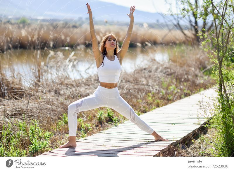 Young woman doing yoga in nature. Lifestyle Beautiful Wellness Relaxation Meditation Summer Sports Yoga Human being Youth (Young adults) Woman Adults 1