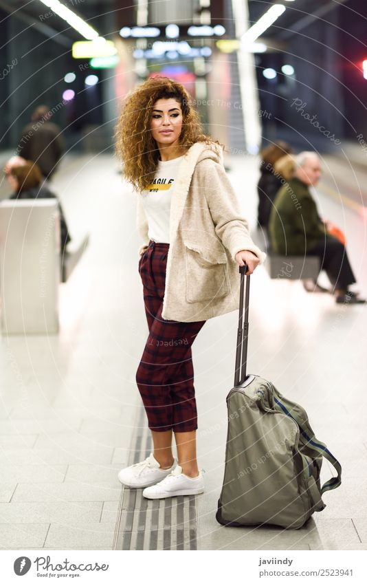 Young Arab woman tourist waiting her train in a subway station Lifestyle Style Vacation & Travel Tourism Trip Human being Young woman Youth (Young adults) Woman