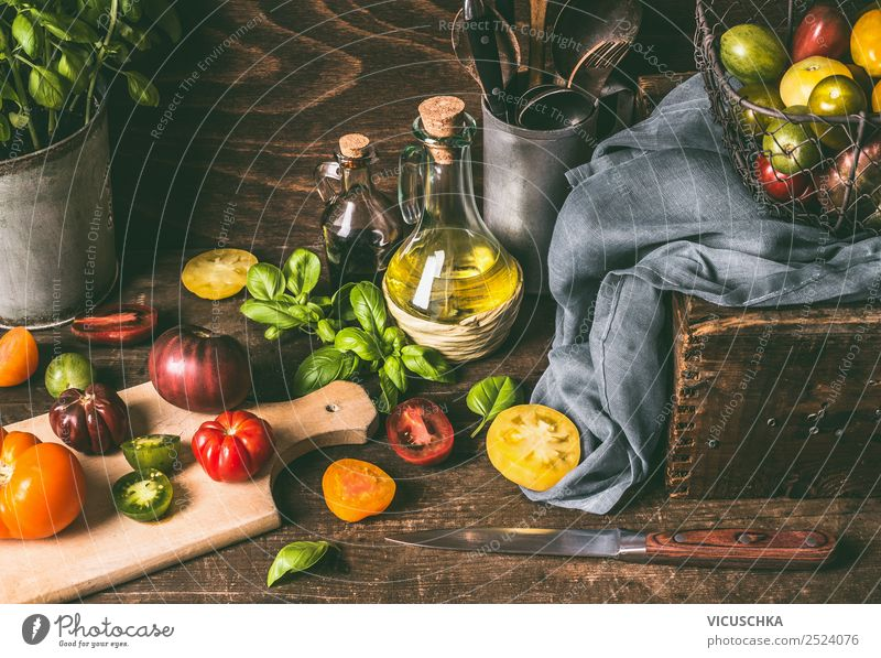 Colorful tomatoes on the kitchen table with basil Food Vegetable Lettuce Salad Herbs and spices Cooking oil Nutrition Lunch Organic produce Vegetarian diet Diet