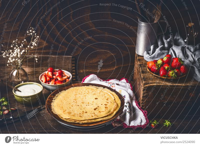 Pancakes on rustic kitchen table with strawberries Food Fruit Dessert Breakfast Organic produce Vegetarian diet Diet Crockery Plate Bowl Cutlery Style Design