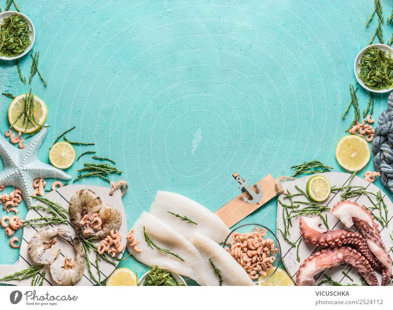 Seafood on a blue background with algae Food Nutrition Lunch Shopping Style Design Healthy Eating Restaurant Background picture Shrimps Octopus Dish Gourmet