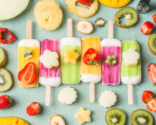Ice on a stick with colorful fruit and fruit slices Food Fruit Ice cream Nutrition Style Design Summer Food photograph Berries Eating ice on a stick