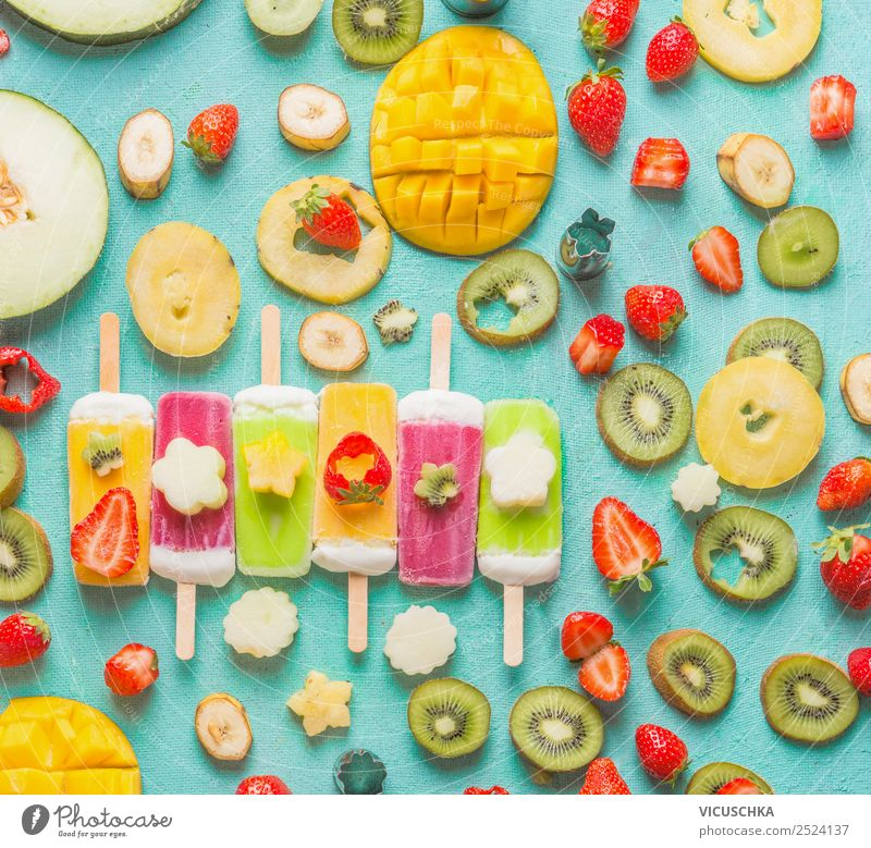 Colorful ice cream on a stick with fruit and berries Ingredients Food Fruit Ice cream Nutrition Style Design Healthy Eating Summer Background picture Mango