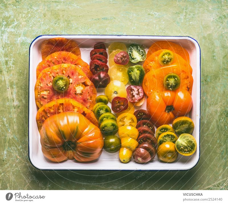 Colourful sliced tomatoes Food Vegetable Nutrition Lunch Organic produce Vegetarian diet Diet Crockery Style Design Healthy Eating Table Tomato Multicoloured