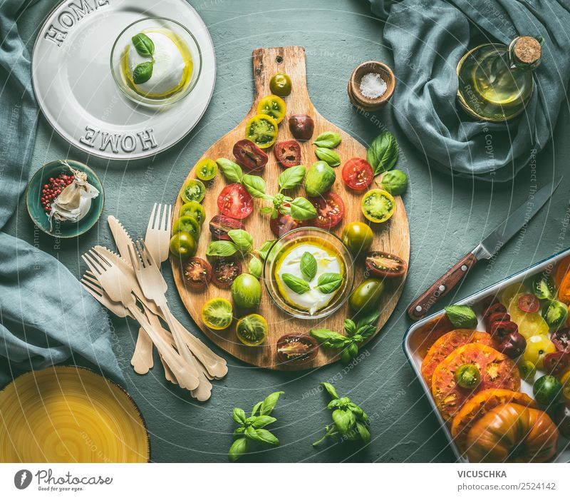 Colourful tomatoes with mozzarella cheese on the kitchen table Food Cheese Vegetable Lettuce Salad Herbs and spices Nutrition Lunch Dinner Buffet Brunch