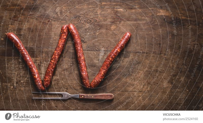 Letter W made with fried sausages Food Sausage Nutrition Fork Style Design Barbecue (apparatus) Background picture Text Symbols and metaphors Letters (alphabet)